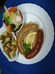 Bavarian sausage platter with smokie and bratwurst